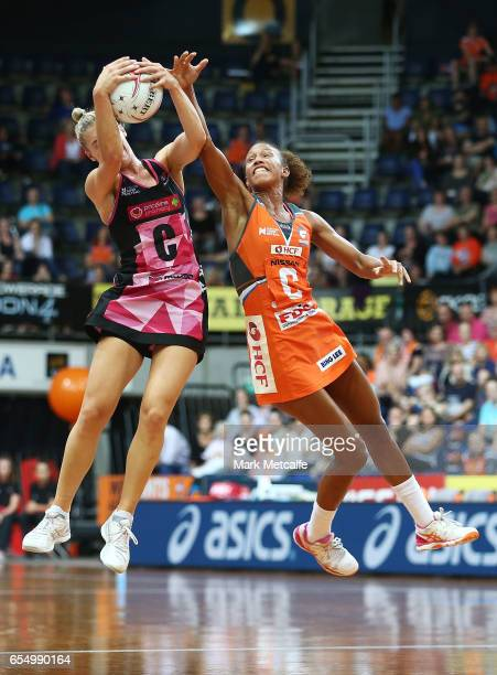 Serena Guthrie of the Giants and Gia Abernethy of the Thunderbirds contest possession during the round five Super Netball match between the Giants...