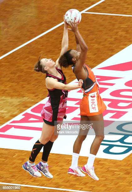 Serena Guthrie of the Giants and Jade Clarke of the Thunderbirds contest possession during the round five Super Netball match between the Giants and...