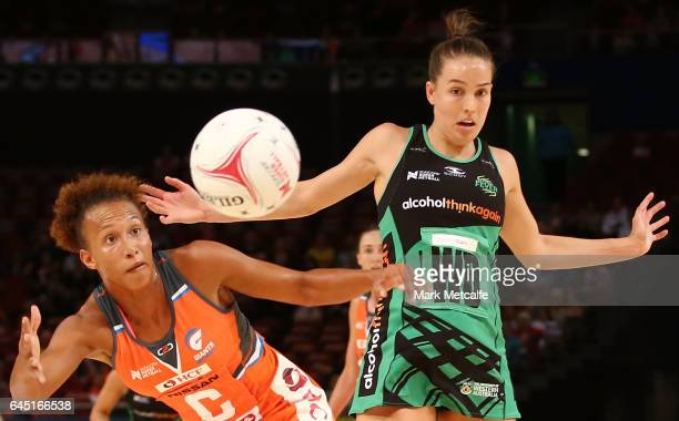 Serena Guthrie of the Giants and Shannon England of the Fever contest possession during the round two Super Netball match between the Giants and the...
