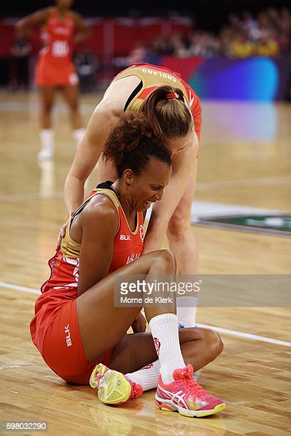 Serena Guthrie of the Roses is helped by a teammate after falling hard to the ground during the International Test match between the Australian...