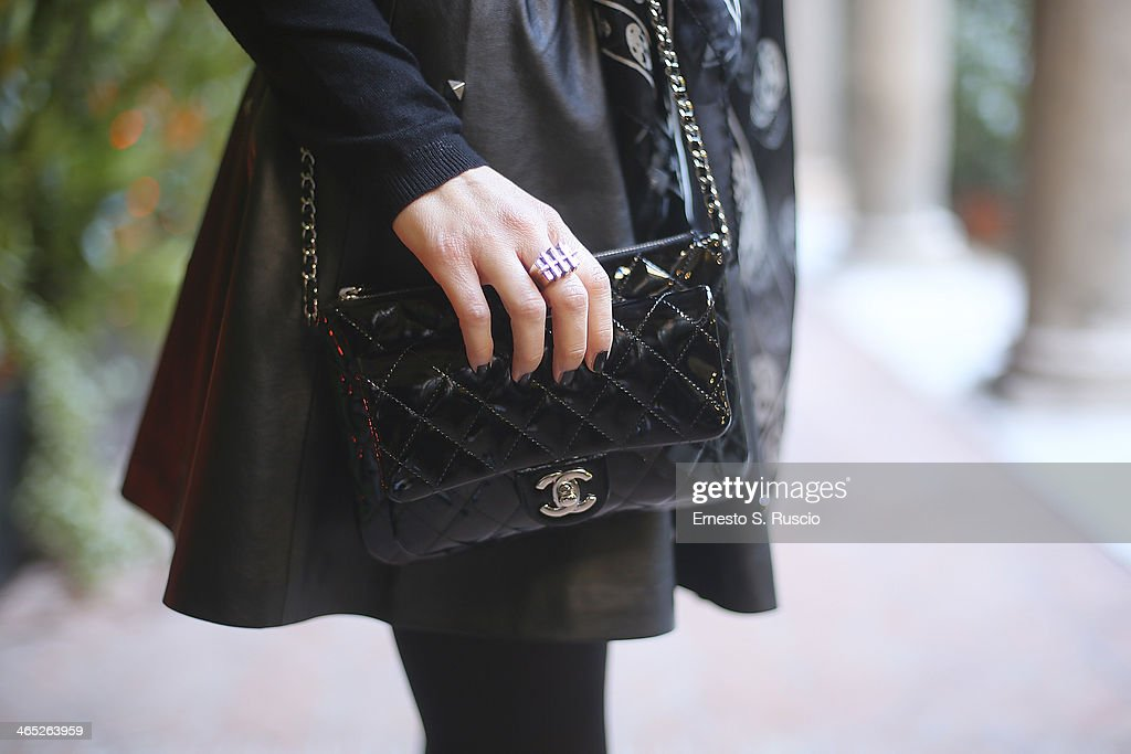 Serena Iaricci wears Chanel bag Alexander McQueen foulard HM skirt and Zara boots on day 3 Rome Fashion Week Spring/Summer 2014 on January 26 2014 in...