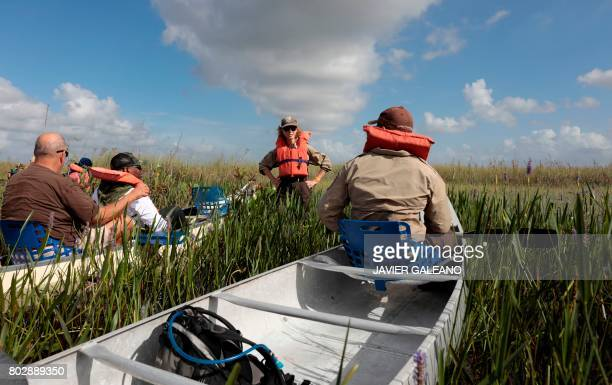 Serena Rinker a US Fish Wildlife Service officer speaks during a canoe trial into the Everglades at the Arthur R Marshall Loxahatchee National...