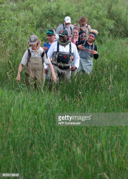 Serena Rinker US Fish Wildlife Service officer and war veteran Chad Brown walk with a Soul River group during a river training at the Arthur R...
