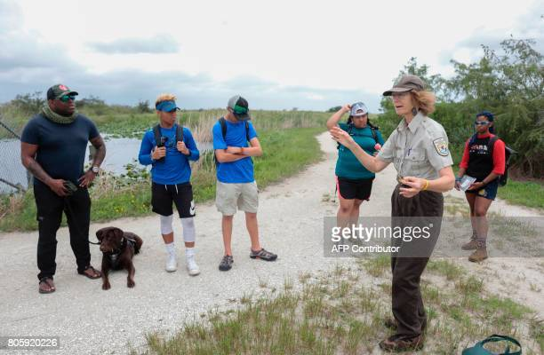 Serena Rinker US Fish Wildlife Service officer speaks during a GPS challenge with a Soul River youth group at the Arthur R Marshall Loxahatchee...
