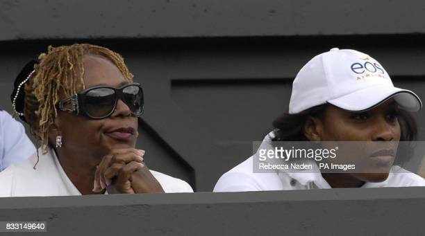 Serena sits with mother Brandy watching her sister Venus Williams in action against Russia's Svetlana Kuznetsova