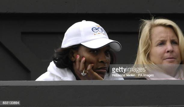 Serena watches her sister Venus Williams in action against Russia's Svetlana Kuznetsova during The All England Lawn Tennis Championship at Wimbledon