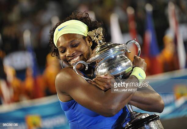 Serena Wiliams of the US holds the winners trophy after her game against Dinara Safina of Russia in their women's tennis finals match on day 13 of...