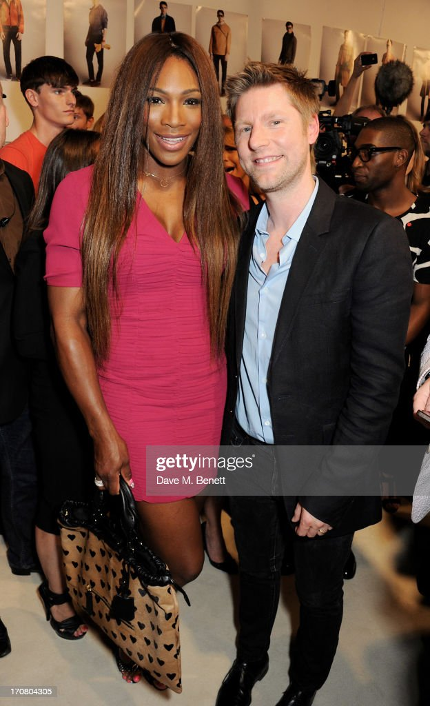 Serena Williams (L) and Burberry Chief Creative Officer Chrsitopher Bailey pose backstage at Burberry Menswear Spring/Summer 2014 at Kensington Gardens on June 18, 2013 in London, England.