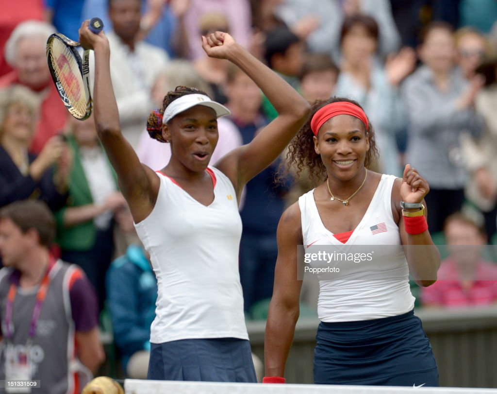 Serena Williams (R) and her sister Venus Williams of the United States celebrate victory over Andrea Hlavackova and Lucie Hradecka of Czech Republic in the Women's Doubles Tennis gold medal match on Day 9 of the London 2012 Olympic Games at the All England Lawn Tennis and Croquet Club on August 5, 2012 in London, England.