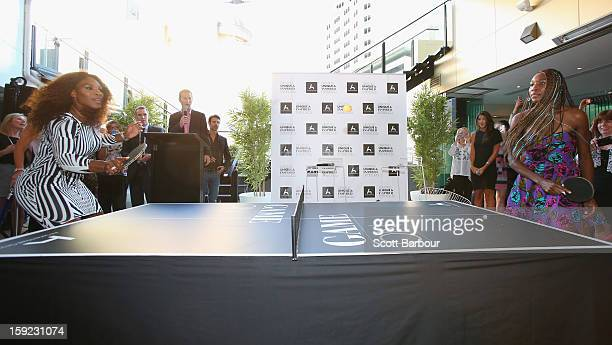 Serena Williams and her sister Venus Williams play table tennis at a 'Welcome to Melbourne' event hosted by the Olsen Hotel on January 10 2013 in...