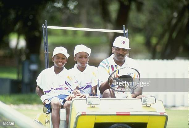 Serena Williams and her sister Venus Williams ride with their father Richard Williams at a tennis camp in Florida Mandatory Credit Ken Levine...