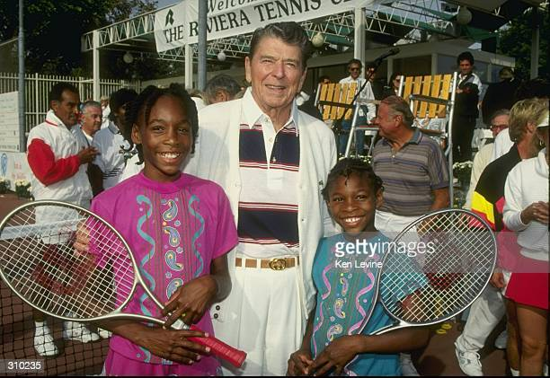 Serena Williams and her sister Venus Williams stand with former president Ronald Reagan at a tennis camp in Florida Mandatory Credit Ken Levine...