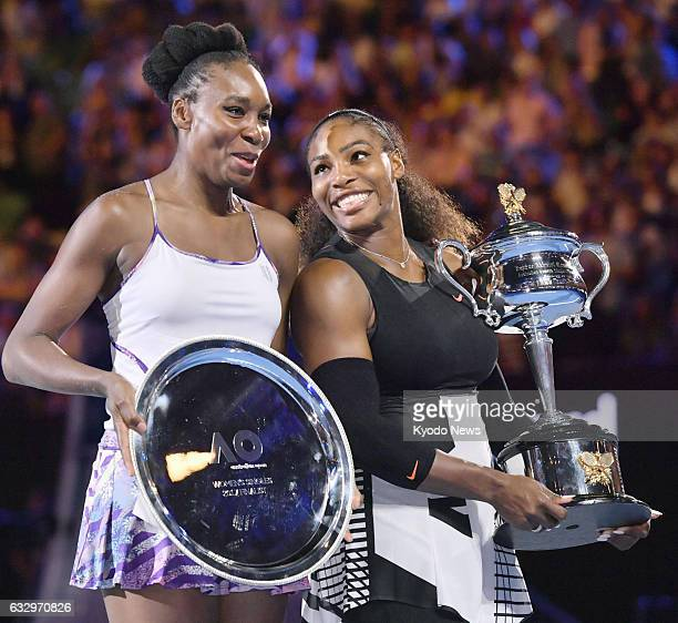 Serena Williams and Venus Williams of the United States attend an award ceremony following their Australian Open women's singles final in Melbourne...
