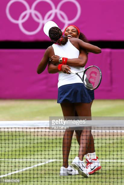 Serena Williams and Venus Williams of the United States celebrate after defeating Andrea Hlavackova and Lucie Hradecka of Czech Republic in the...
