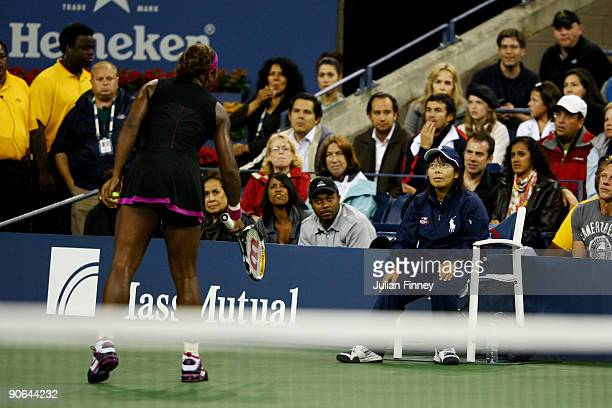 Serena Williams argues with a line judge during her Women's Singles Semifinal match against Kim Clijsters of Belgium on day thirteen of the 2009 US...