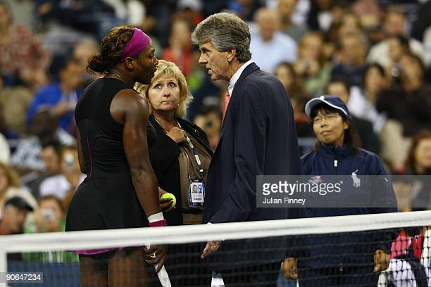 Serena Williams argues with Brian Early and Donna Kelso after disqualified for a default during the Women's Singles Semifinal match against to Kim...