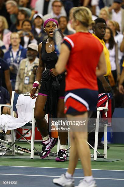 Serena Williams calls out to Kim Clijsters of Belgium after Williams was disqualified by a foot fault during the Women's Singles Semifinal match on...