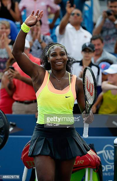 Serena Williams celebrates match point after defeating Simona Halep of Romania to win the womens finals of the Western Southern Open at the Linder...