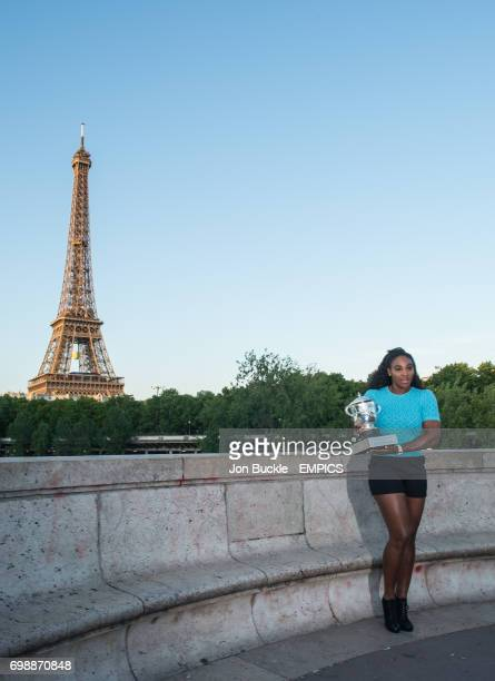Serena Williams celebrates with the a Trophy shoot at the Eiffel Tower after claiming her 20th Grand slam title on day fourteen of the French Open at...