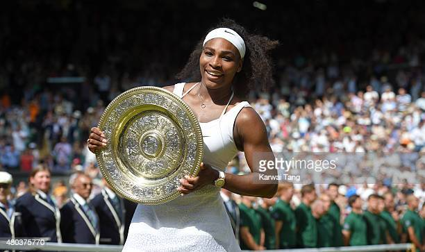 Serena Williams celebrates with the Venus Rosewater Dish after her victory in the Final Of The Ladies' Singles against Garbine Muguruza of Spain...