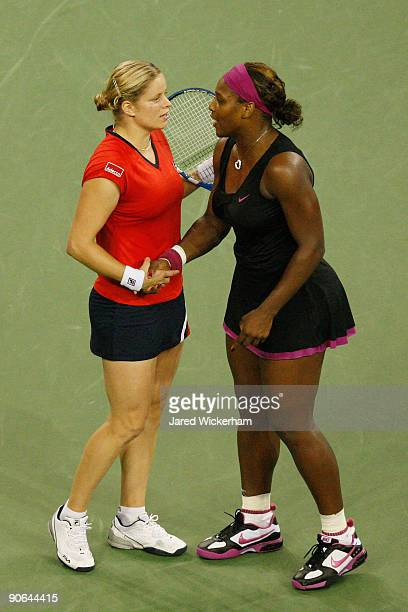 Serena Williams congratulates Kim Clijsters of Belgium after Williams was disqualified by a foot fault during the Women's Singles Semifinal match on...