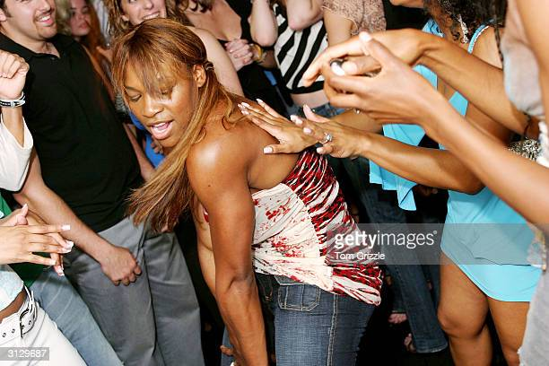 Serena Williams dances during Venus Williams and Ocean Drive Magazine party at Mynt Ultra Lounge in South Beach March 24 2004 in Miami Florida