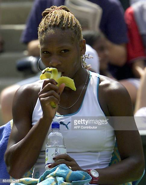 US Serena Williams eats a banana during her quarter final match against compatriot Jennifer Capriati at the All England Tennis Championships in...