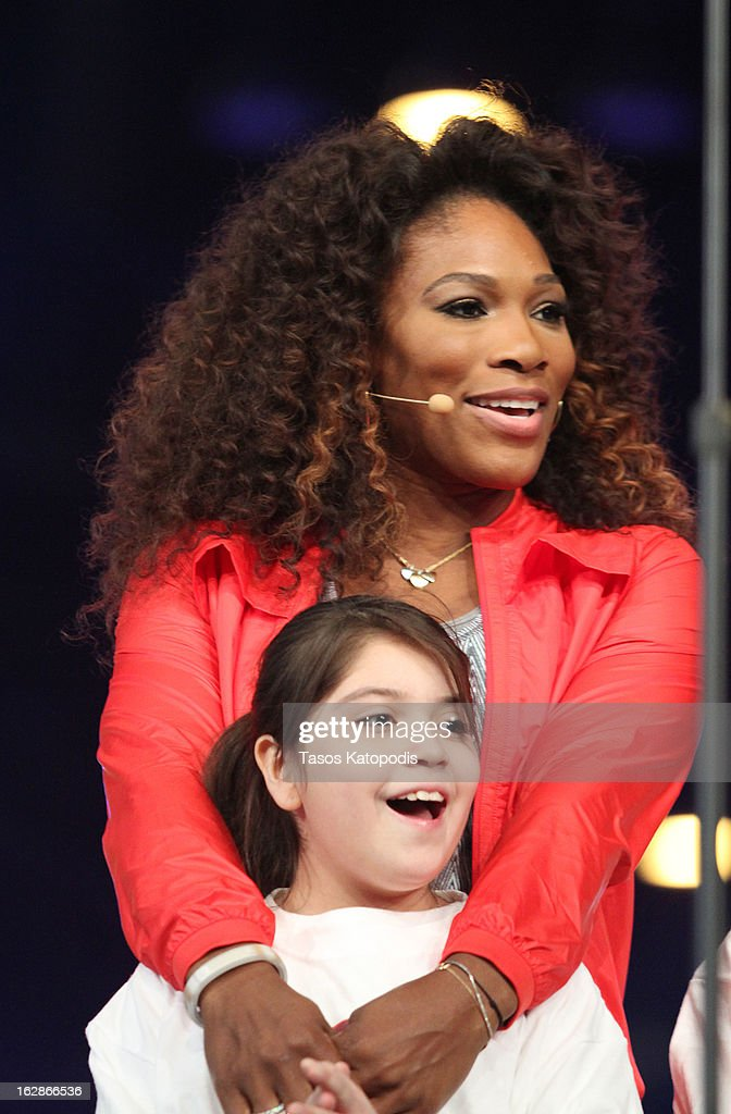 <a gi-track='captionPersonalityLinkClicked' href=/galleries/search?phrase=Serena+Williams&family=editorial&specificpeople=171101 ng-click='$event.stopPropagation()'>Serena Williams</a> enters the stage at McCormick Place during a debut of a school exercise program February 28, 2013 in Chicago, Ililnois. Michelle Obama unveiled a new program called 'Let's Move Active Schools' to help schools create a physical activity programs for students