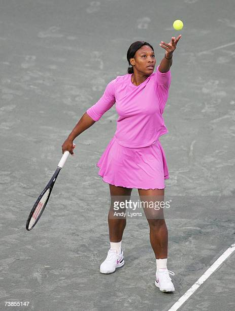 Serena Williams hits a serve during her match against YungJan Chan of Chinese Taipei during the Family Circle Cup at the Family Circle Tennis Center...