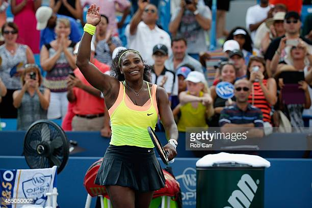 Serena Williams holds celebrates match point after defeating Simona Halep of Romania to win the womens finals of the Western Southern Open at the...