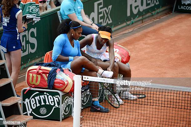 Serena Williams injured and Venus Williams during the Women's Doubles on day four of the French Open 2016 at Roland Garros on May 25 2016 in Paris...