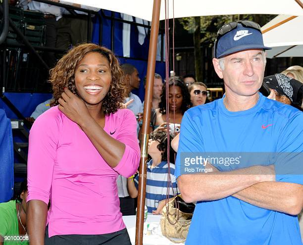 Serena Williams looks on with John McEnroe before their match at the DIRECTV ESPN US Open Experience promoting DIRECTV's mosaic coverage of the US...