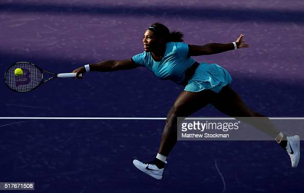 Serena Williams lunges for a shot while playing Zarina Diyas of Kazakhstan during the Miami Open presented by Itau at Crandon Park Tennis Center on...