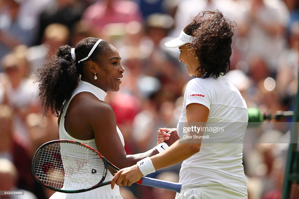 <a gi-track='captionPersonalityLinkClicked' href=/galleries/search?phrase=Serena+Williams+-+Tennis+Player&family=editorial&specificpeople=171101 ng-click='$event.stopPropagation()'>Serena Williams</a> of The United States and Amra Sadikovic of Switzerland shake hands following the Ladies Singles first round match on day two of the Wimbledon Lawn Tennis Championships at the All England Lawn Tennis and Croquet Club on June 28, 2016 in London, England.