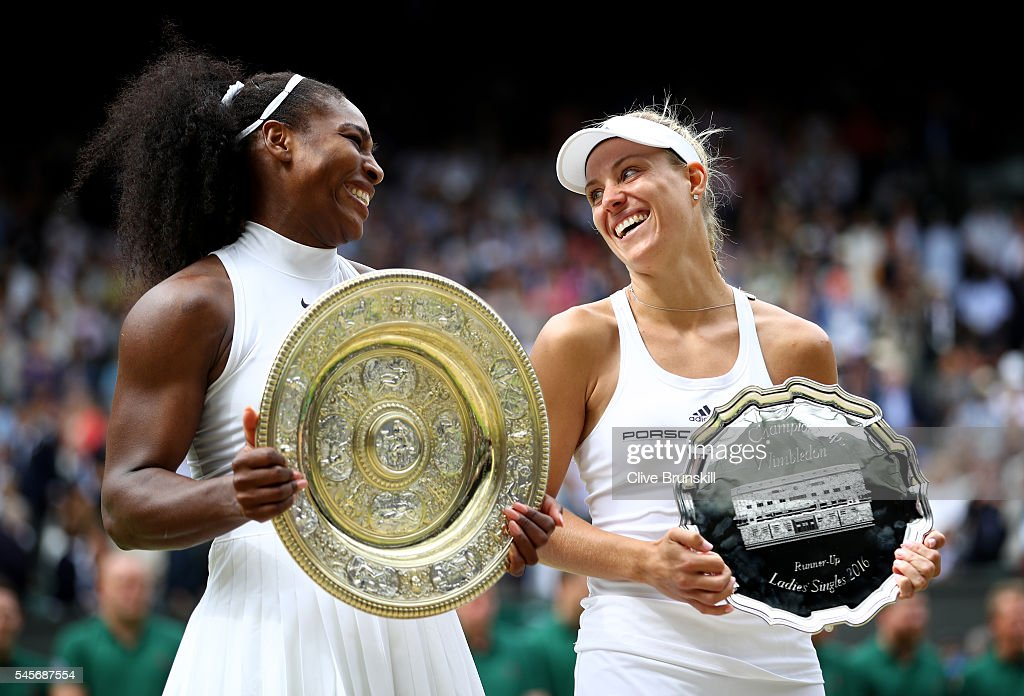 Serena Williams of The United States and Angelique Kerber of Germany in conversation as they hold their trophies following The Ladies Singles Final on day twelve of the Wimbledon Lawn Tennis Championships at the All England Lawn Tennis and Croquet Club on July 9, 2016 in London, England.
