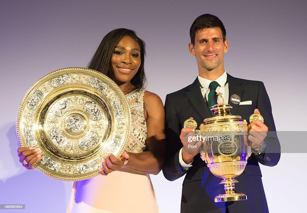 Serena Williams of the United States and Novak Djokovic of Serbia pose on stage at the Champions Dinner at the Guild Hall on day thirteen of the...