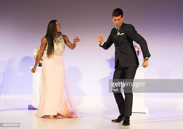 Serena Williams of the United States and Novak Djokovic of Serbia dance on stage at the Champions Dinner at the Guild Hall on day thirteen of the...