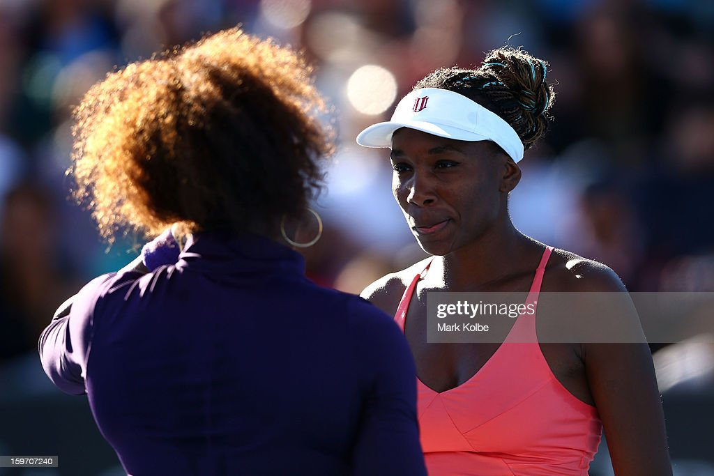 Serena Williams of the United States and Venus Williams of the United States talk tactics in their second round doubles match against Vera Dushevina of Russia and Olga Govortsova of Belarus during day six of the 2013 Australian Open at Melbourne Park on January 19, 2013 in Melbourne, Australia.