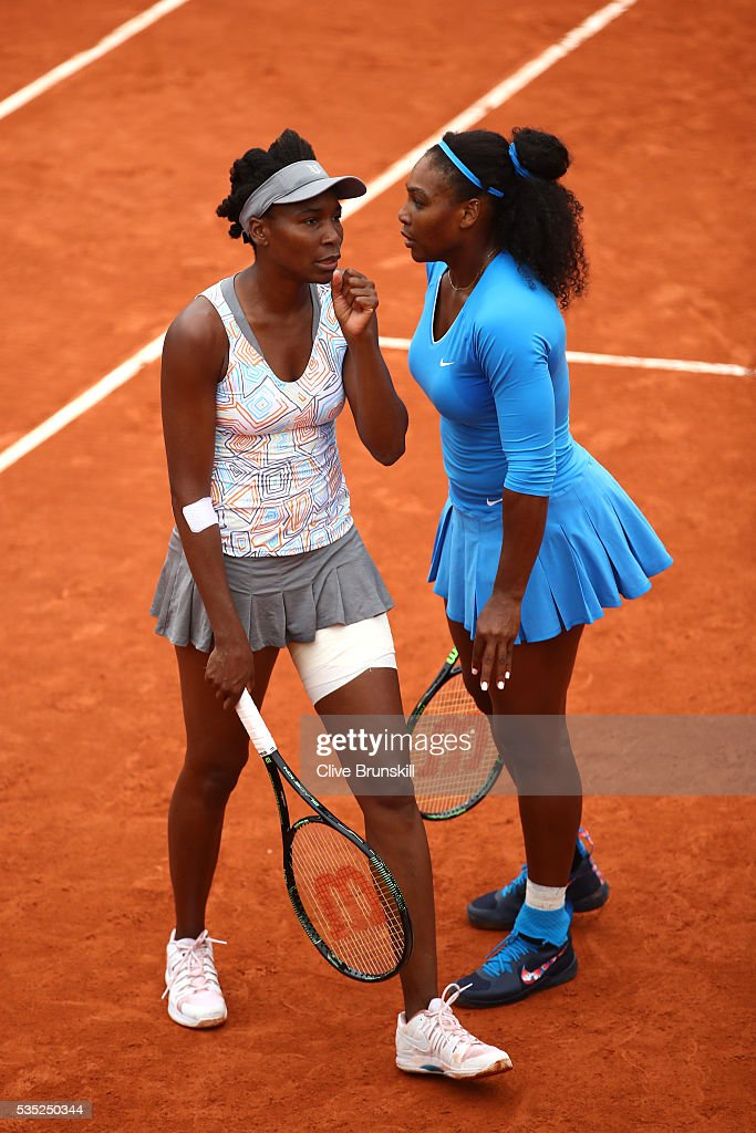 <a gi-track='captionPersonalityLinkClicked' href=/galleries/search?phrase=Serena+Williams&family=editorial&specificpeople=171101 ng-click='$event.stopPropagation()'>Serena Williams</a> of the United States and <a gi-track='captionPersonalityLinkClicked' href=/galleries/search?phrase=Venus+Williams&family=editorial&specificpeople=171981 ng-click='$event.stopPropagation()'>Venus Williams</a> of the United States talk tactics during the Ladies Singles fourth round match against Kki Bertens of Netherlands and Johanna Larsson of Sweden on day eight of the 2016 French Open at Roland Garros on May 29, 2016 in Paris, France.