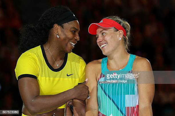 Serena Williams of the United States and winner Angelique Kerber of Germany stand on stage during the trophy presentation following the Women's...