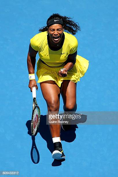 Serena Williams of the United States celebrates a point in her first round match against Camila Giorgi of Italy during day one of the 2016 Australian...