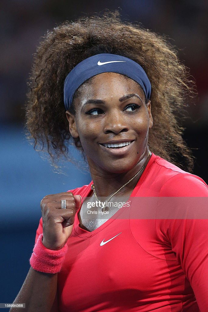 Serena Williams of the United States celebrates after winning her final match against Anastasia Pavlyuchenkova of Russia on day seven of the Brisbane International at Pat Rafter Arena on January 5, 2013 in Brisbane, Australia.