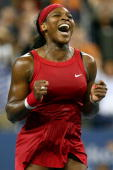 Serena Williams of the United States celebrates after winning championship point against Jelena Jankovic of Serbia during the women's singles finals...