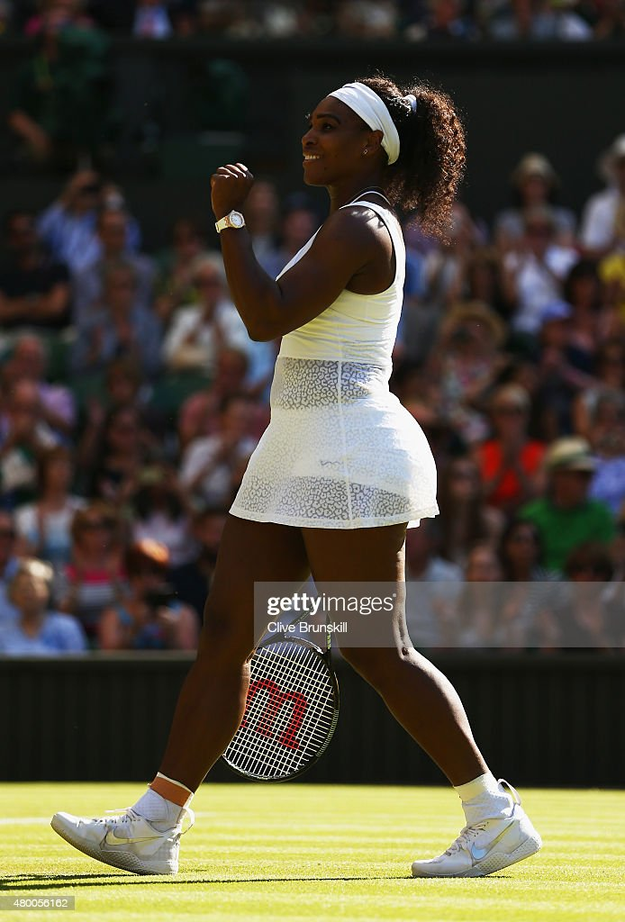 Serena Williams of the United States celebrates after winning the Ladies Singles Semi Final match against Maria Sharapova of Russia during day ten of the Wimbledon Lawn Tennis Championships at the All England Lawn Tennis and Croquet Club on July 9, 2015 in London, England.