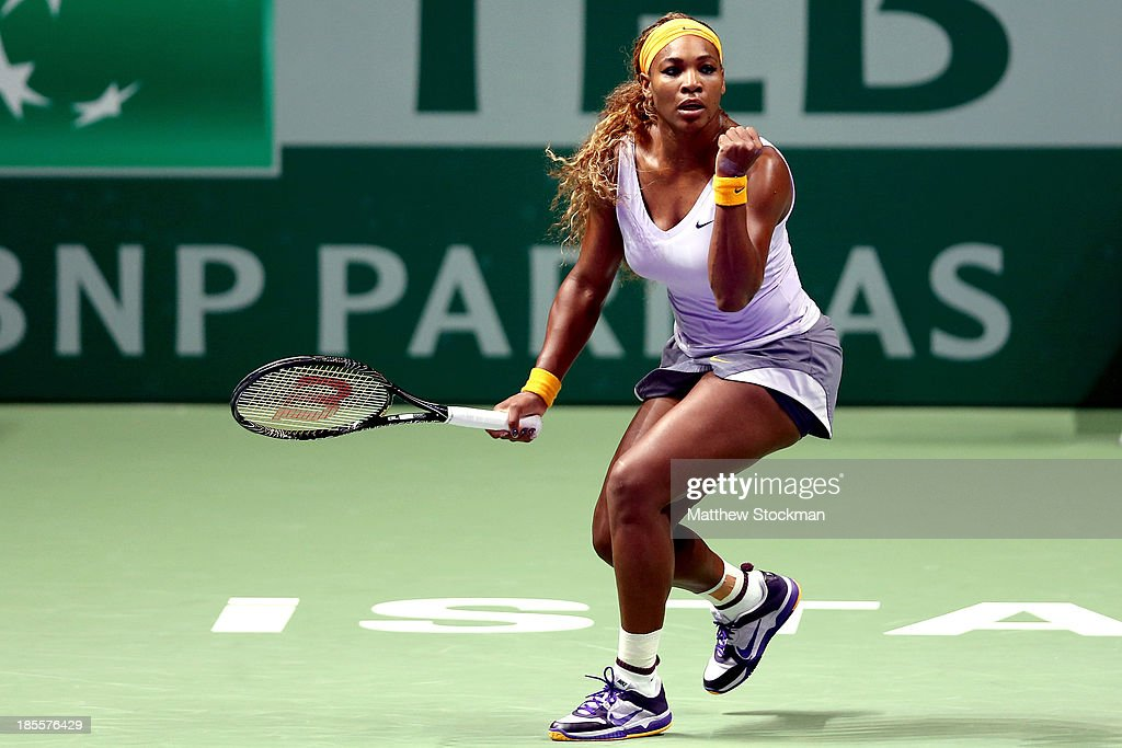 <a gi-track='captionPersonalityLinkClicked' href=/galleries/search?phrase=Serena+Williams&family=editorial&specificpeople=171101 ng-click='$event.stopPropagation()'>Serena Williams</a> of the United States celebrates breaking Angelique Kerber of Germany during day one of the TEB BNP Paribas WTA Championships at the Sinan Erdem Dome on October 22, 2013 in Istanbul, Turkey.