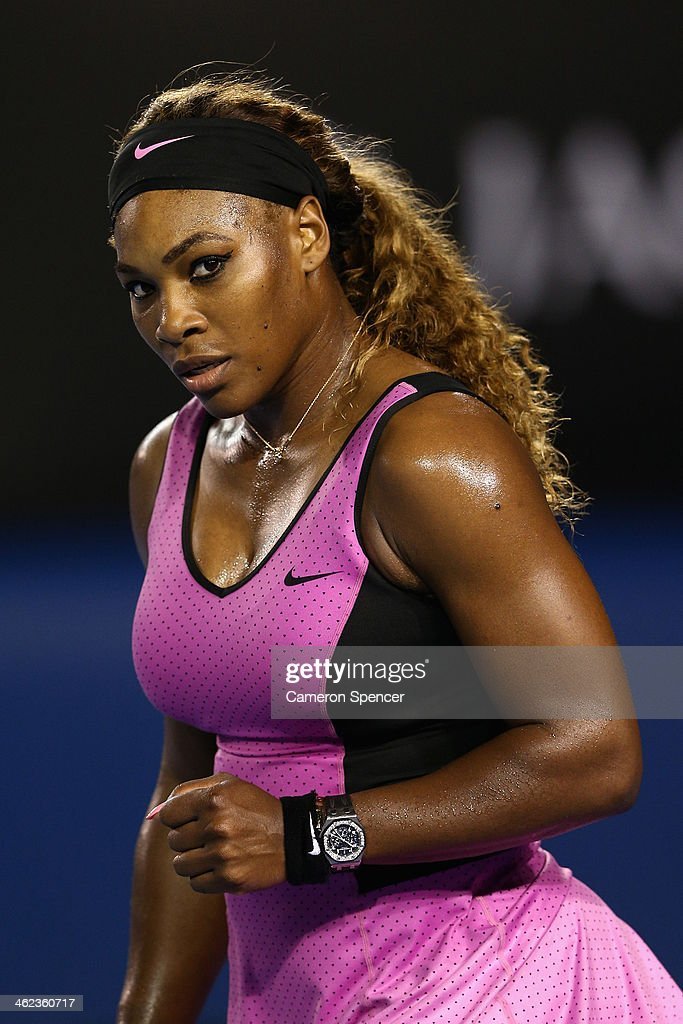 Serena Williams of the United States celebrates match point in her first round match against Ashleigh Barty of Australia during day one of the 2014 Australian Open at Melbourne Park on January 13, 2014 in Melbourne, Australia.