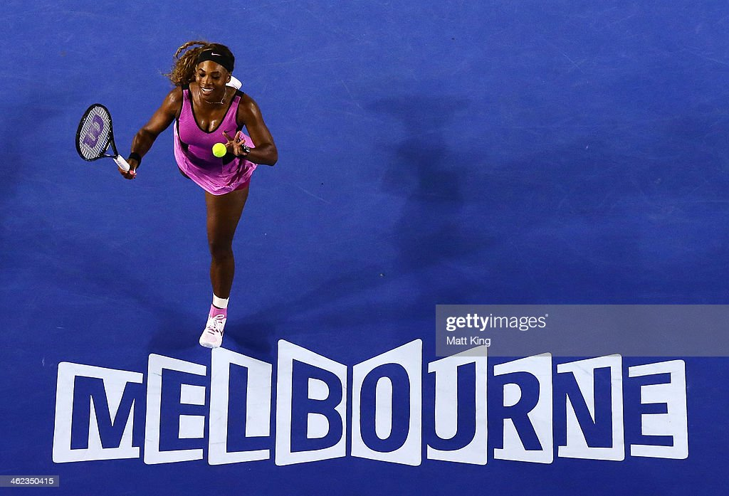 Serena Williams of the United States celebrates winning a point in her first round match against Ashleigh Barty of Australia during day one of the 2014 Australian Open at Melbourne Park on January 13, 2014 in Melbourne, Australia.