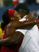 Serena Williams of the United States celebrates with her father Richard after winning championship point against Jelena Jankovic of Serbia during the...