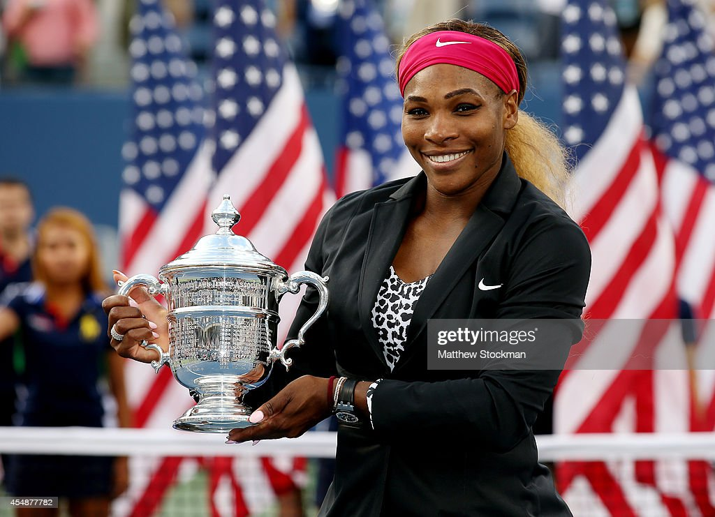 <a gi-track='captionPersonalityLinkClicked' href=/galleries/search?phrase=Serena+Williams&family=editorial&specificpeople=171101 ng-click='$event.stopPropagation()'>Serena Williams</a> of the United States celebrates with the trophy after defeating Caroline Wozniacki of Denmark to win their women's singles final match on Day fourteen of the 2014 US Open at the USTA Billie Jean King National Tennis Center on September 7, 2014 in the Flushing neighborhood of the Queens borough of New York City. Williams defeated Wozniacki in two sets by a score of 6-3, 6-3.