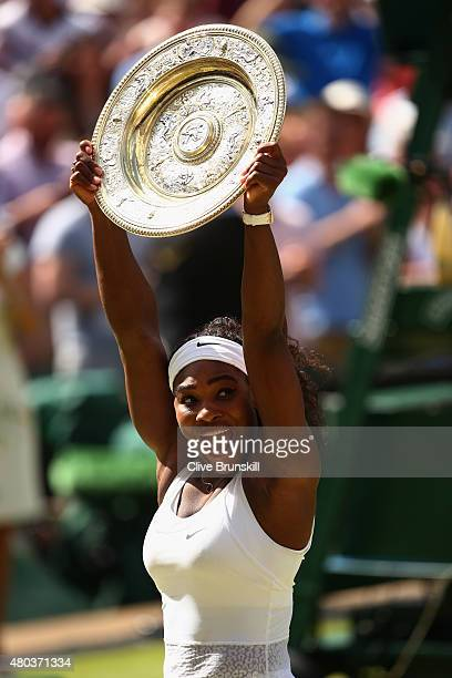 Serena Williams of the United States celebrates with the Venus Rosewater Dish after her victory in the Final Of The Ladies' Singles against Garbine...